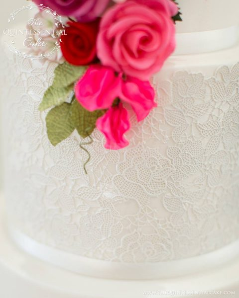 Romantic Wedding Cake featuring Sugar Lace with Pink & Red Sugar Flowers | The Quintessential Cake | Chicago | Luxury Wedding Cakes | Chicago Illuminating Company