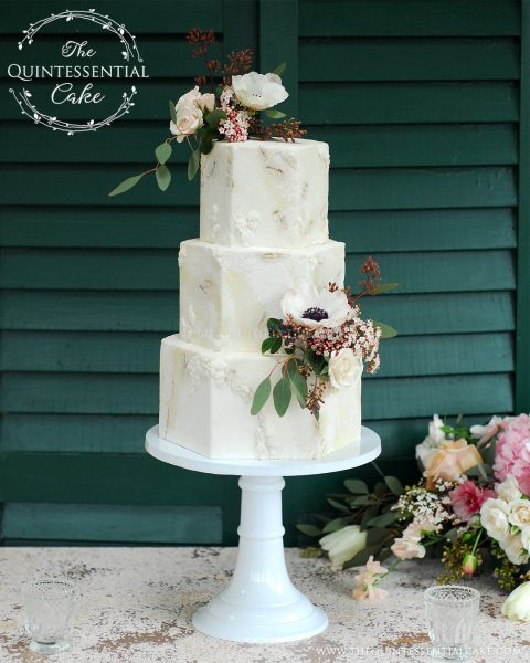 Rough Stone Texture with Bas Relief Detailing and Fresh Flowers | The Quintessential Cake | Chicago | Luxury Wedding Cakes | Danada House